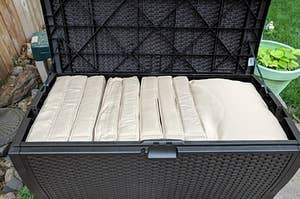 the storage bench with pillows inside