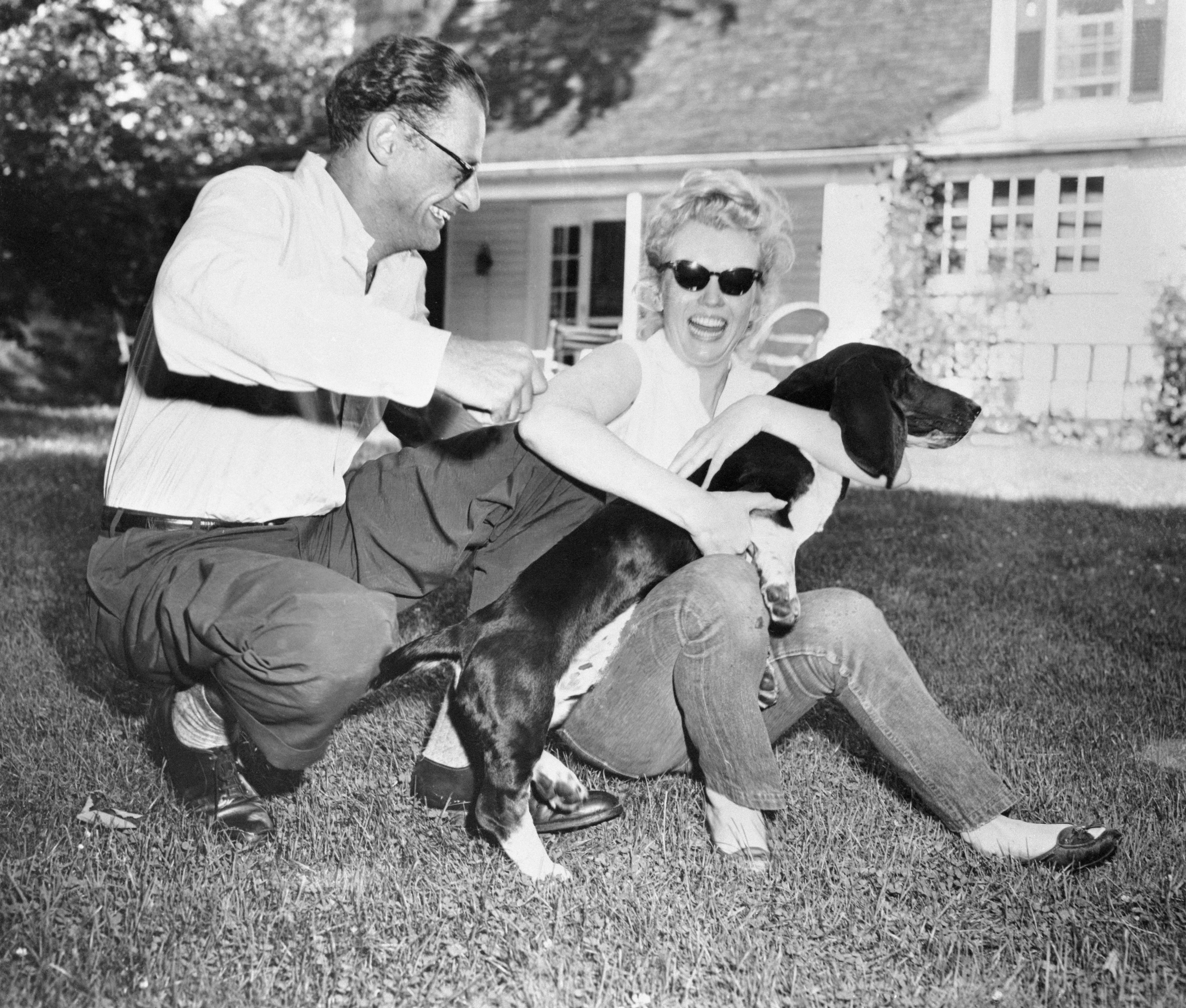 Marilyn Monroe with her soon-to-be husband Arthur Miller and his dog