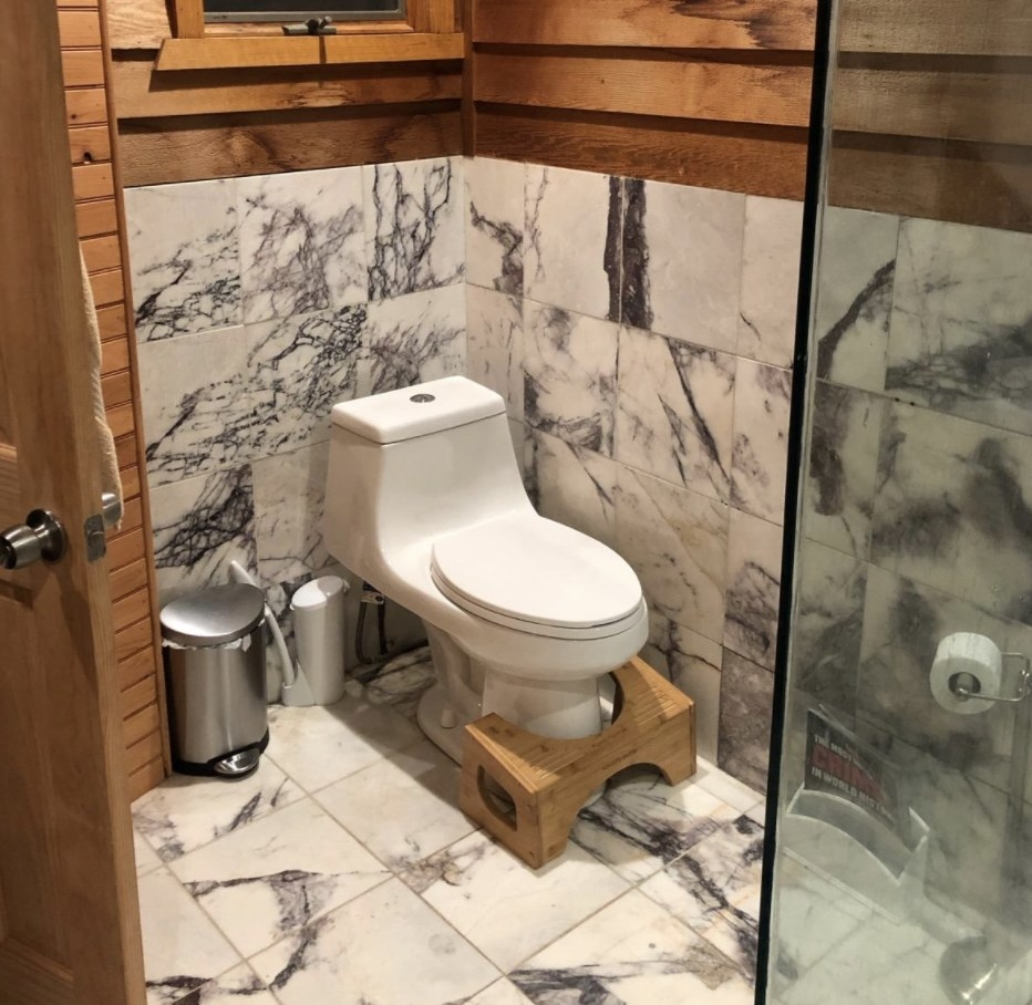 The bamboo squatty potty in a bathroom