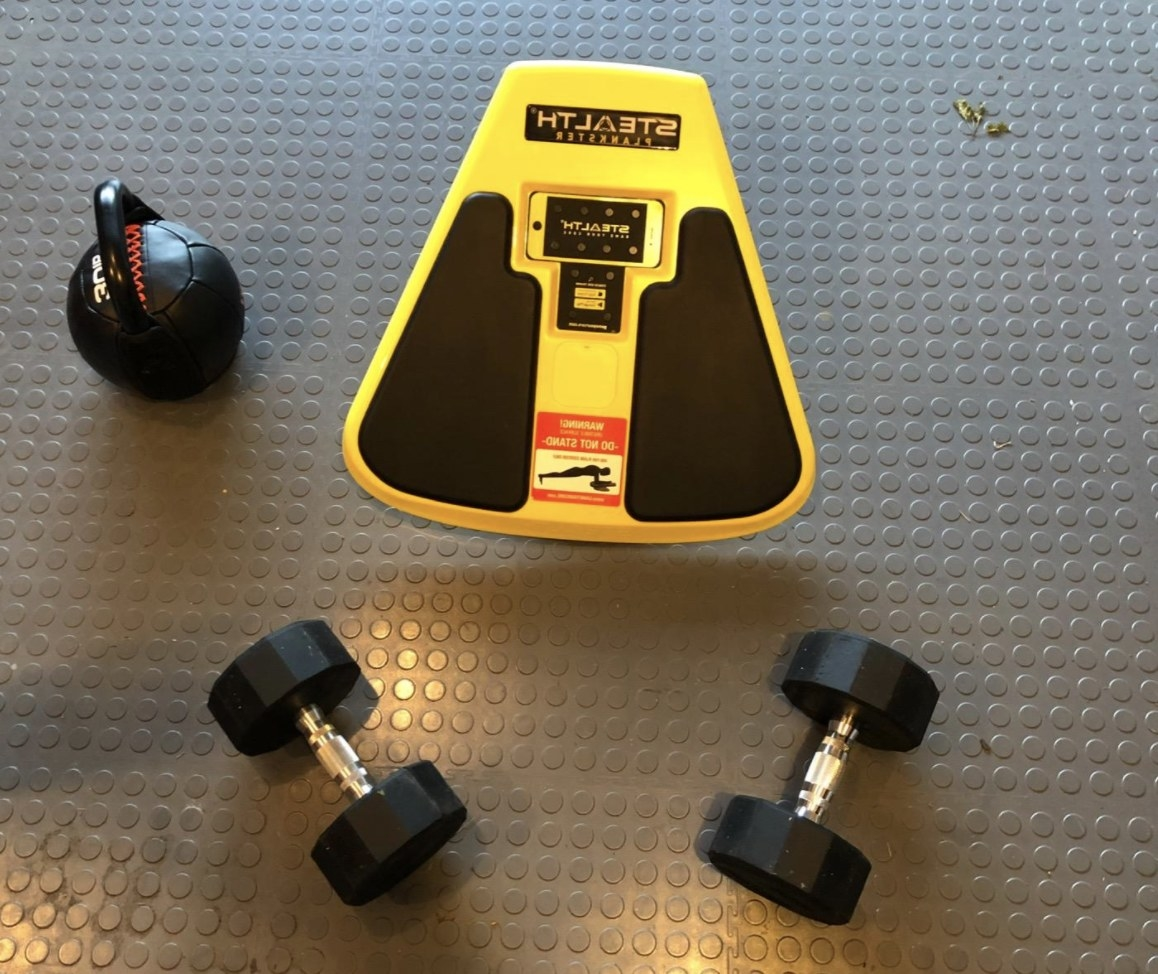 The core trainer next to dumbbells