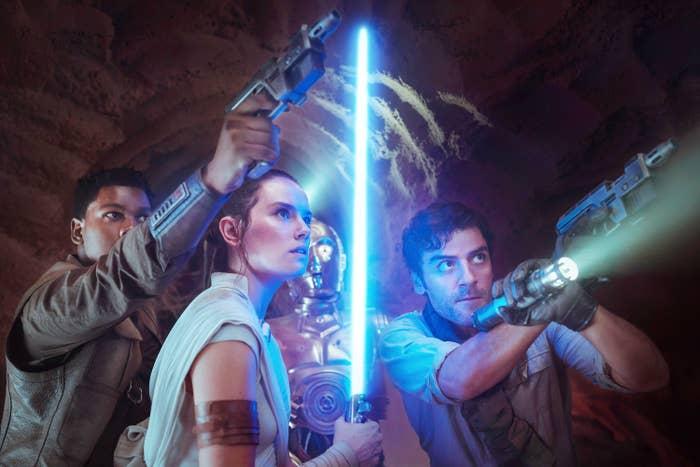 "John Boyega as Finn, Daisy Ridley as Rey, Anthony Daniels as C-3PO, Oscar Isaac as Poe Dameron in ""The Rise of Skywalker"""