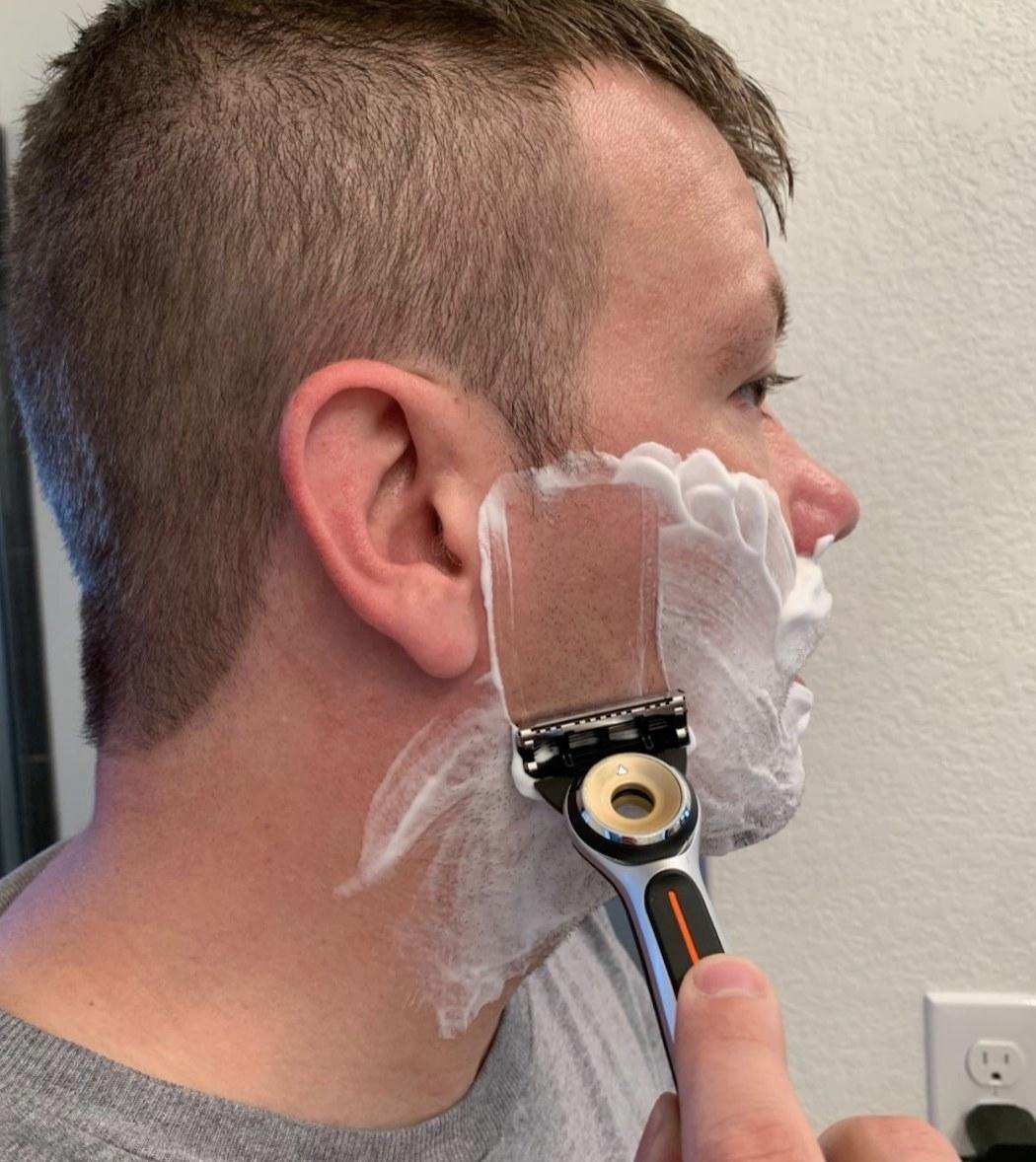 A person shaving