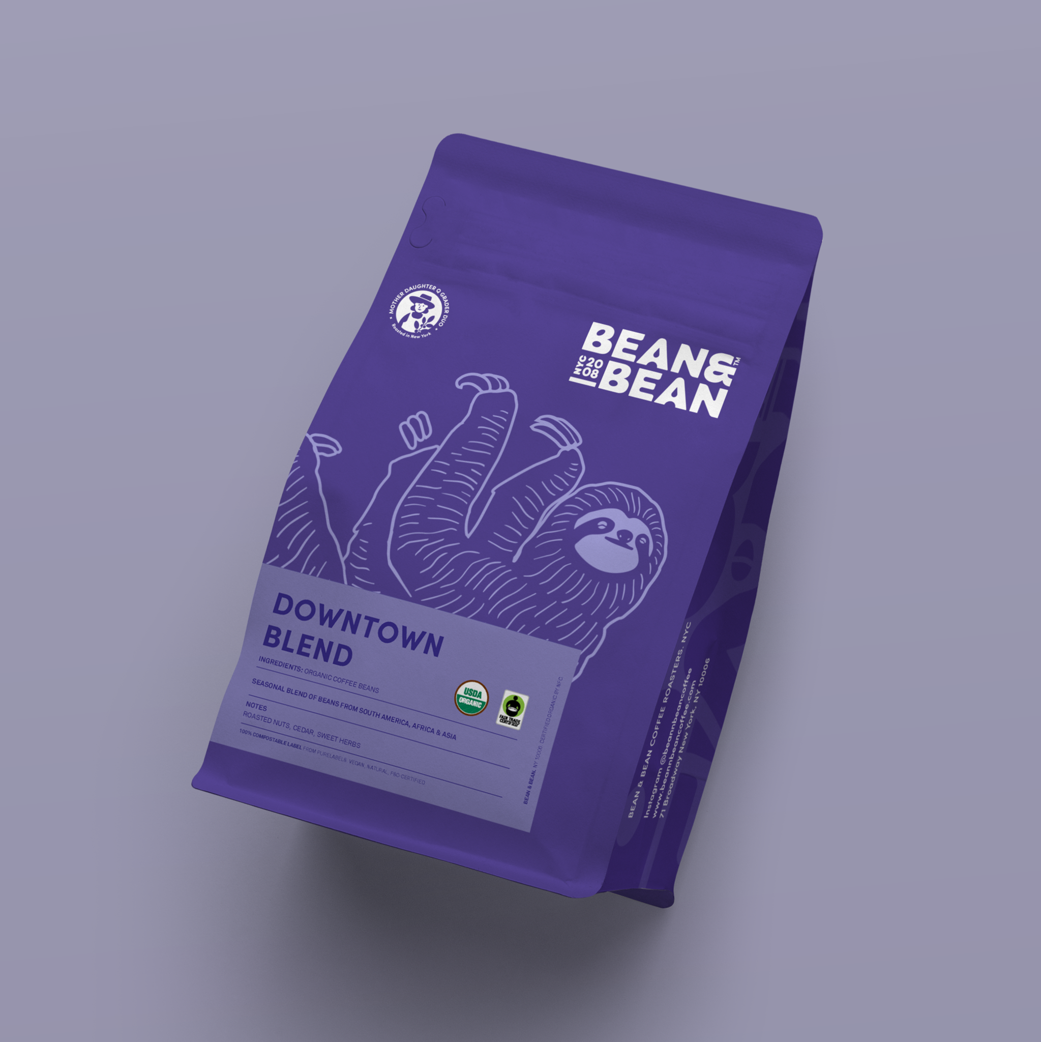 purple bag of bean and bean downtown blend with a sloth on it