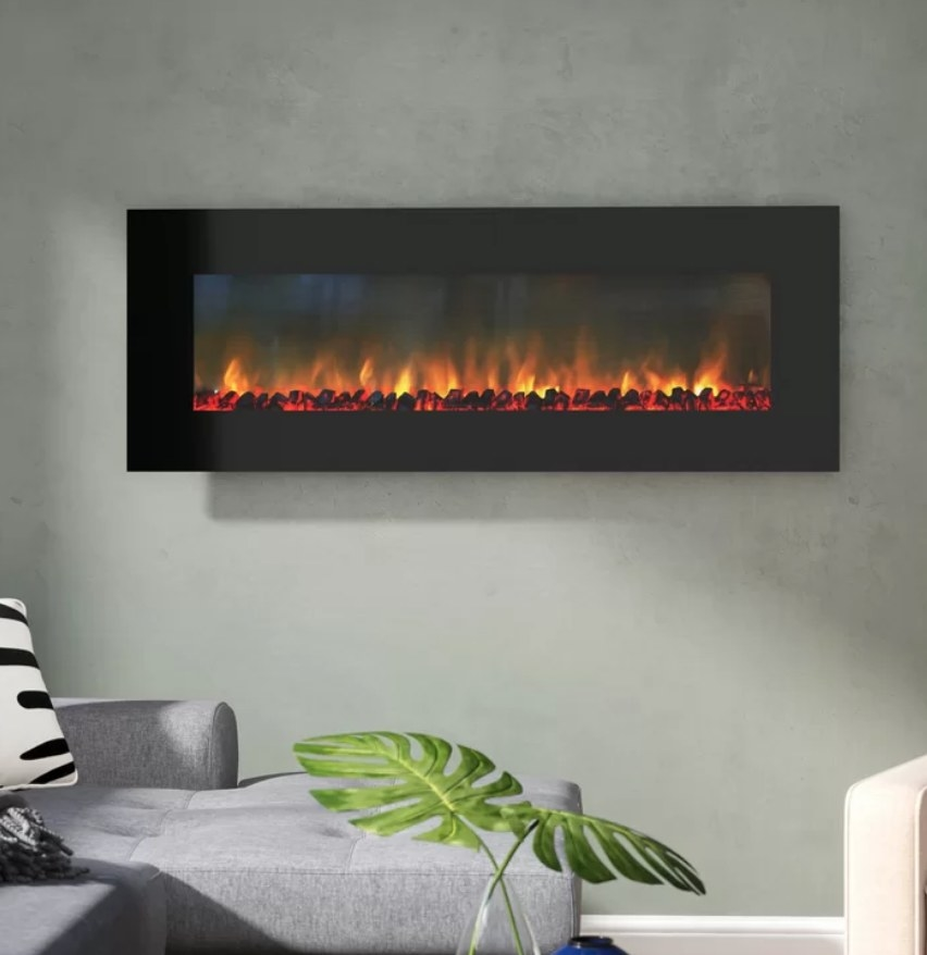 An electric fireplace mounted on a wall in a living room