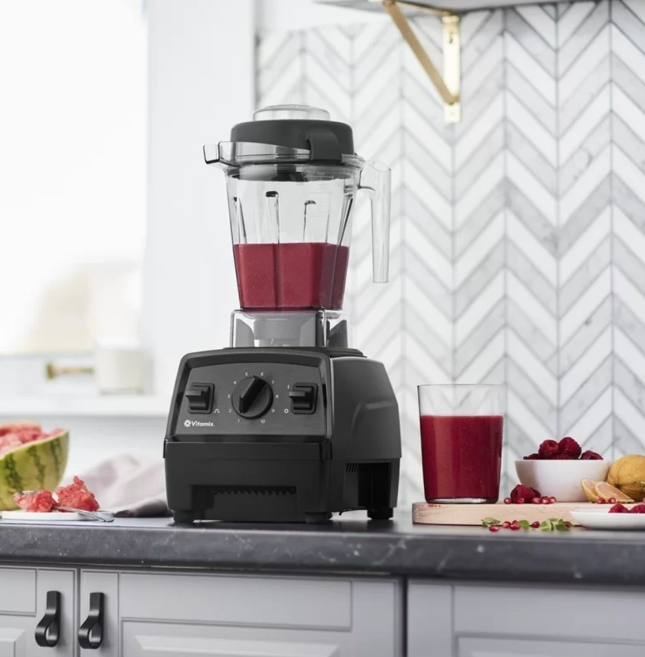 A Vitamix filled with a delicious smoothie on a kitchen countertop