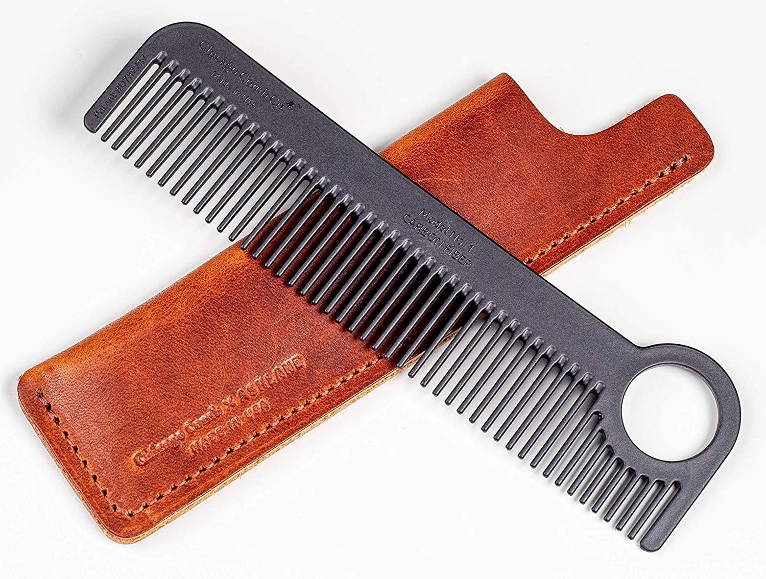 comb and leather carrying case