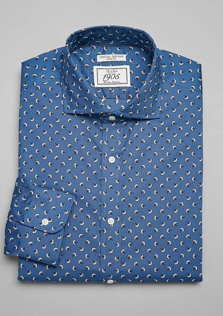 blue long-sleeved button-down shirt with small white leaf pattern all over it