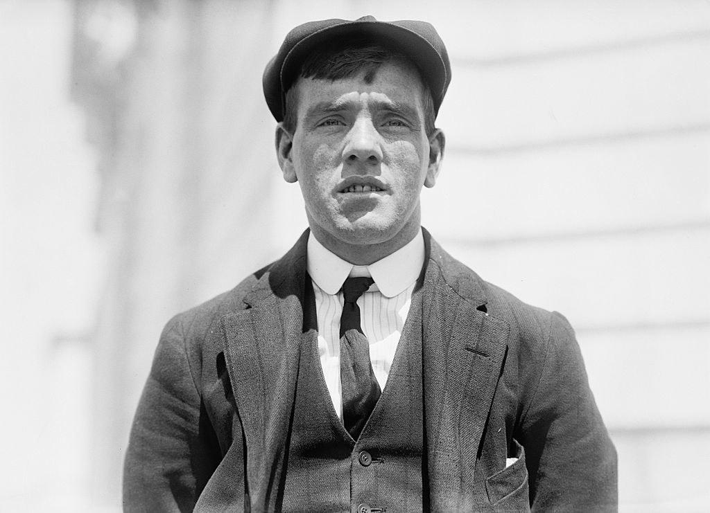 A young Frederick Fleet in a newsboy cap