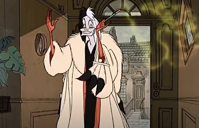 A screenshot from the animated film of Cruella holding her cigarette