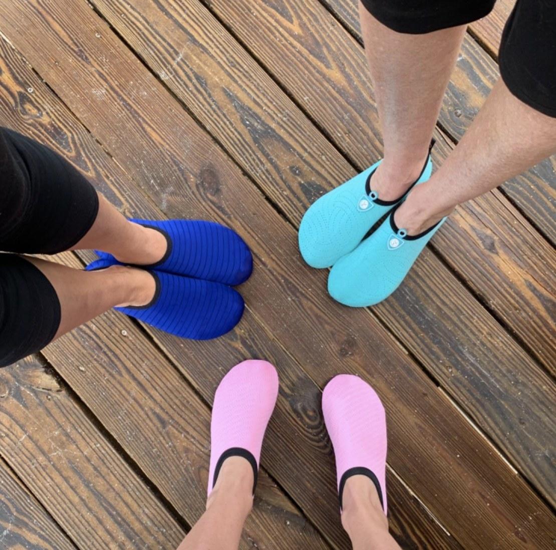 Three people wearing aqua socks