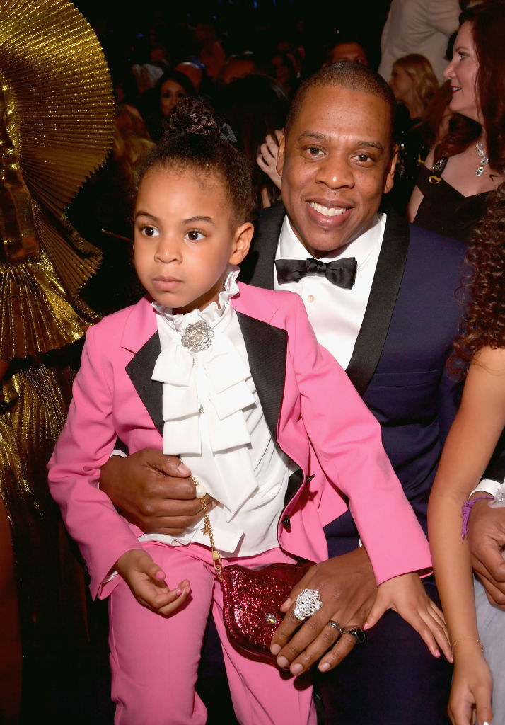Jay-Z (R) and Blue Ivy Carter during The 59th Grammy Awards