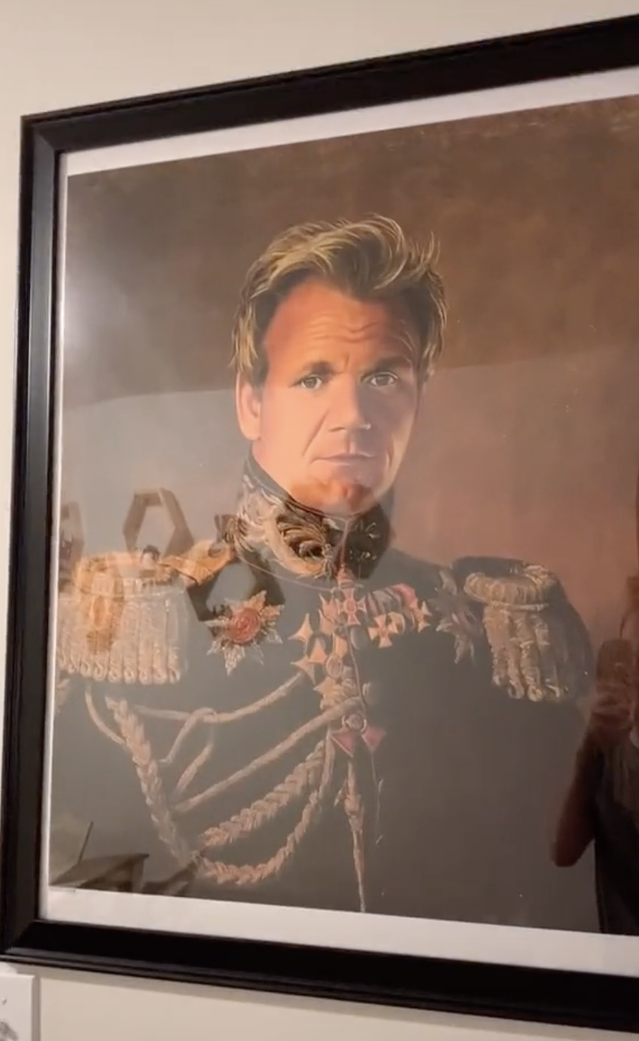A painting portrait of Gordon Ramsay in a medieval prince attire