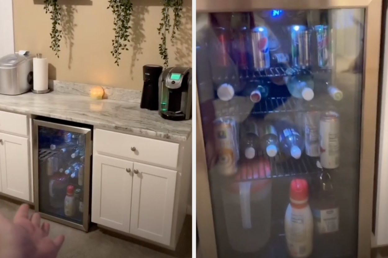 A countertop with a full coffee setup and a mini fridge installed in between two cabinets