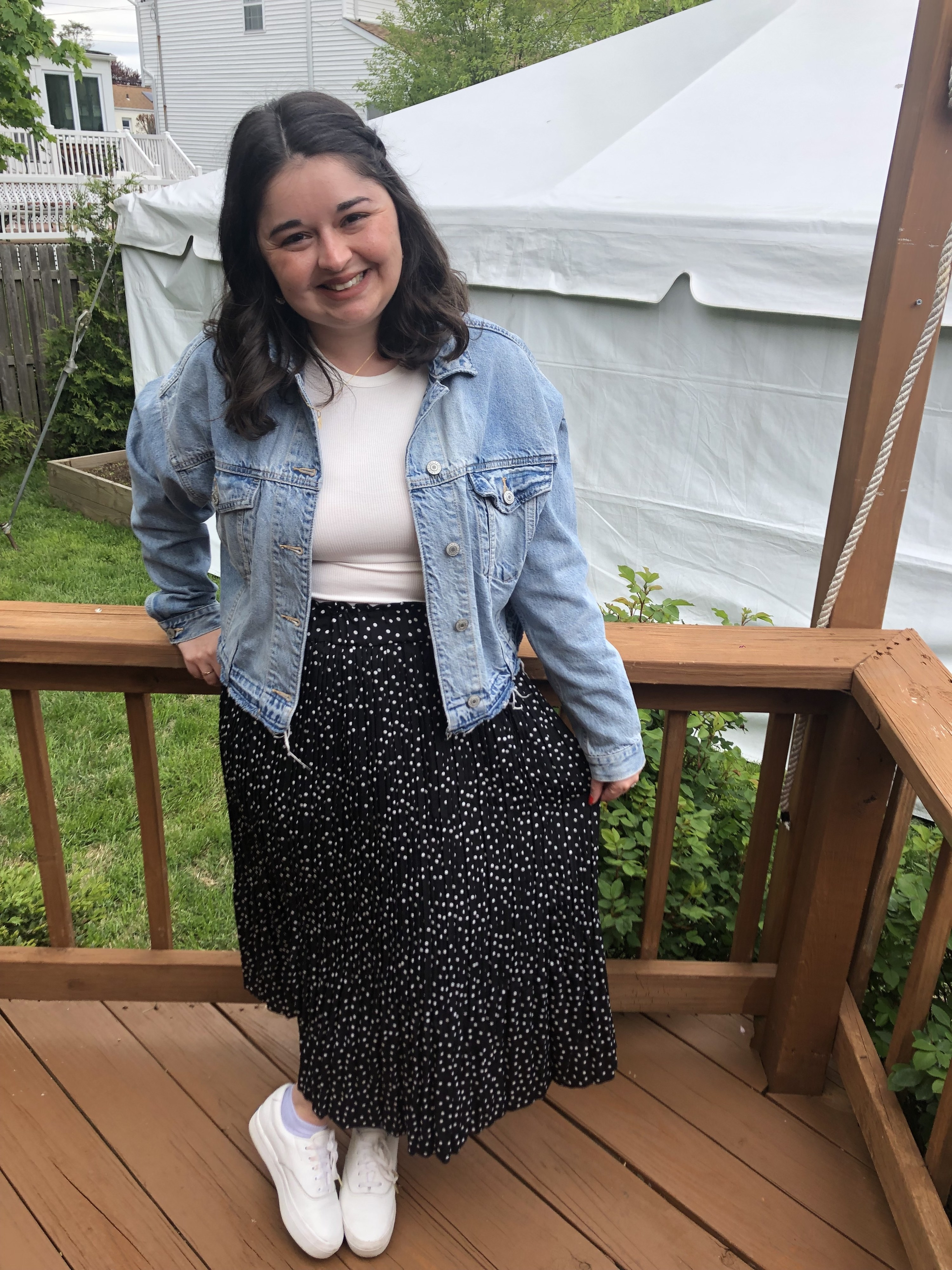 buzzfeed editor wearing a long black maxi skirt with smalll white polka dots and a pleated ruffle on the bottom