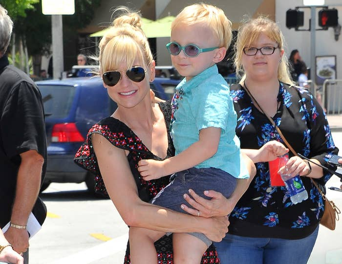 Anna carries her son, Jack, into an event