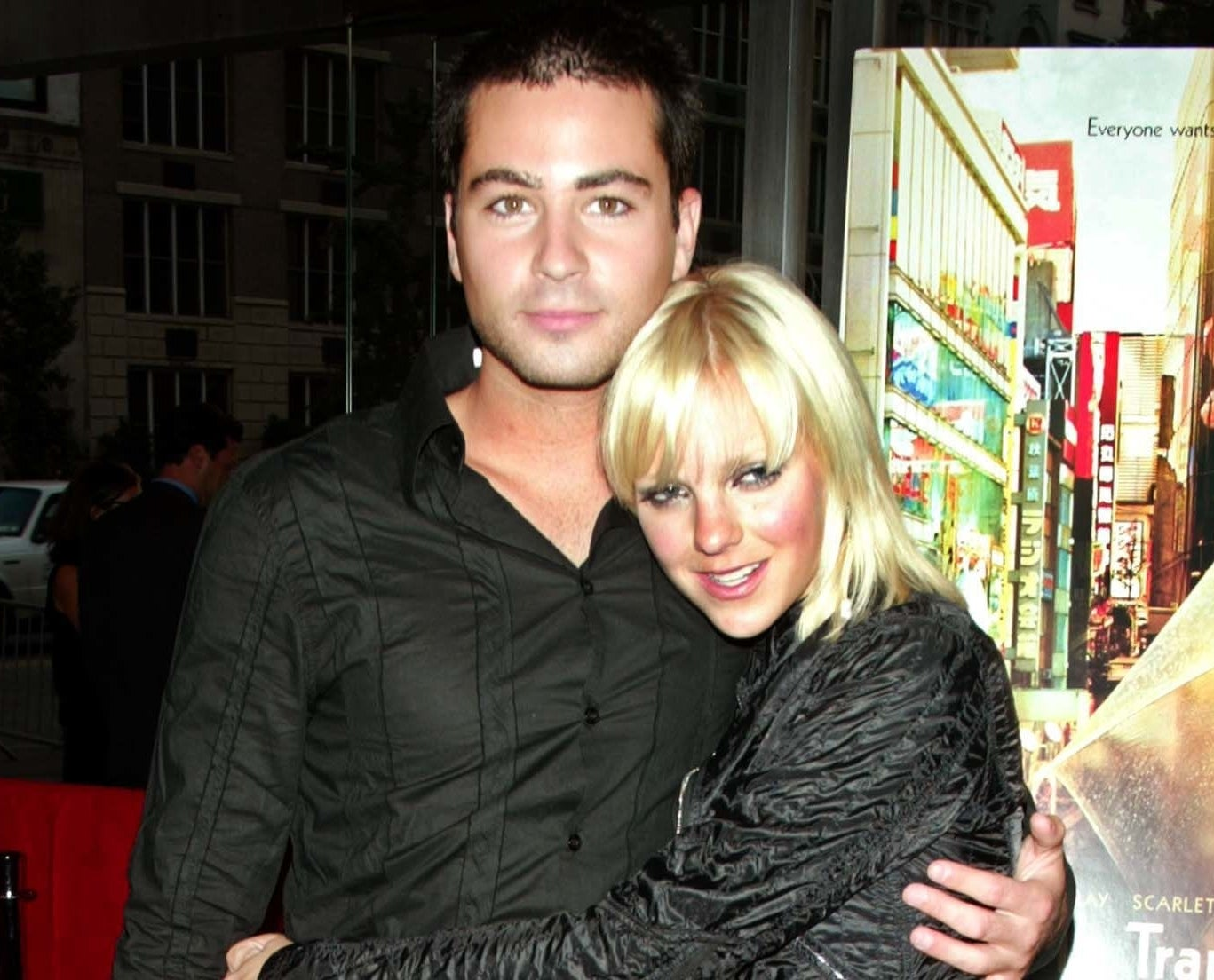 Anna holds onto Ben at an event