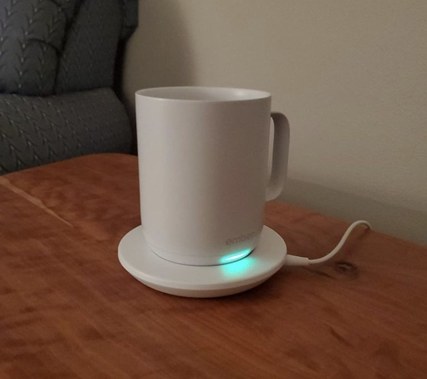 reviewer photo of the mug on its charging dock