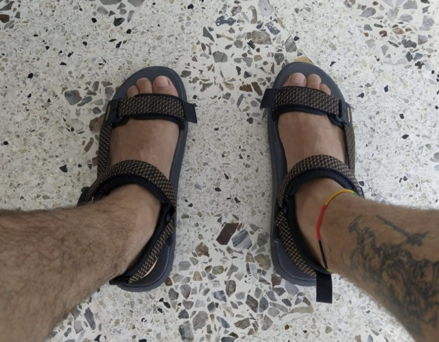 reviewer wearing the sandals