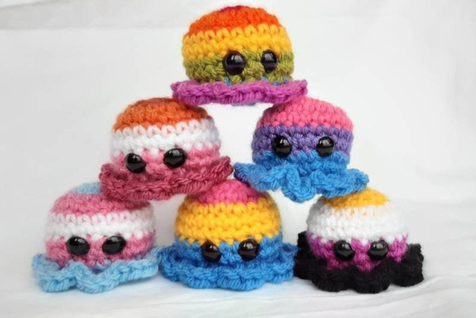octopus-shaped beanies in various LGBT flag colors