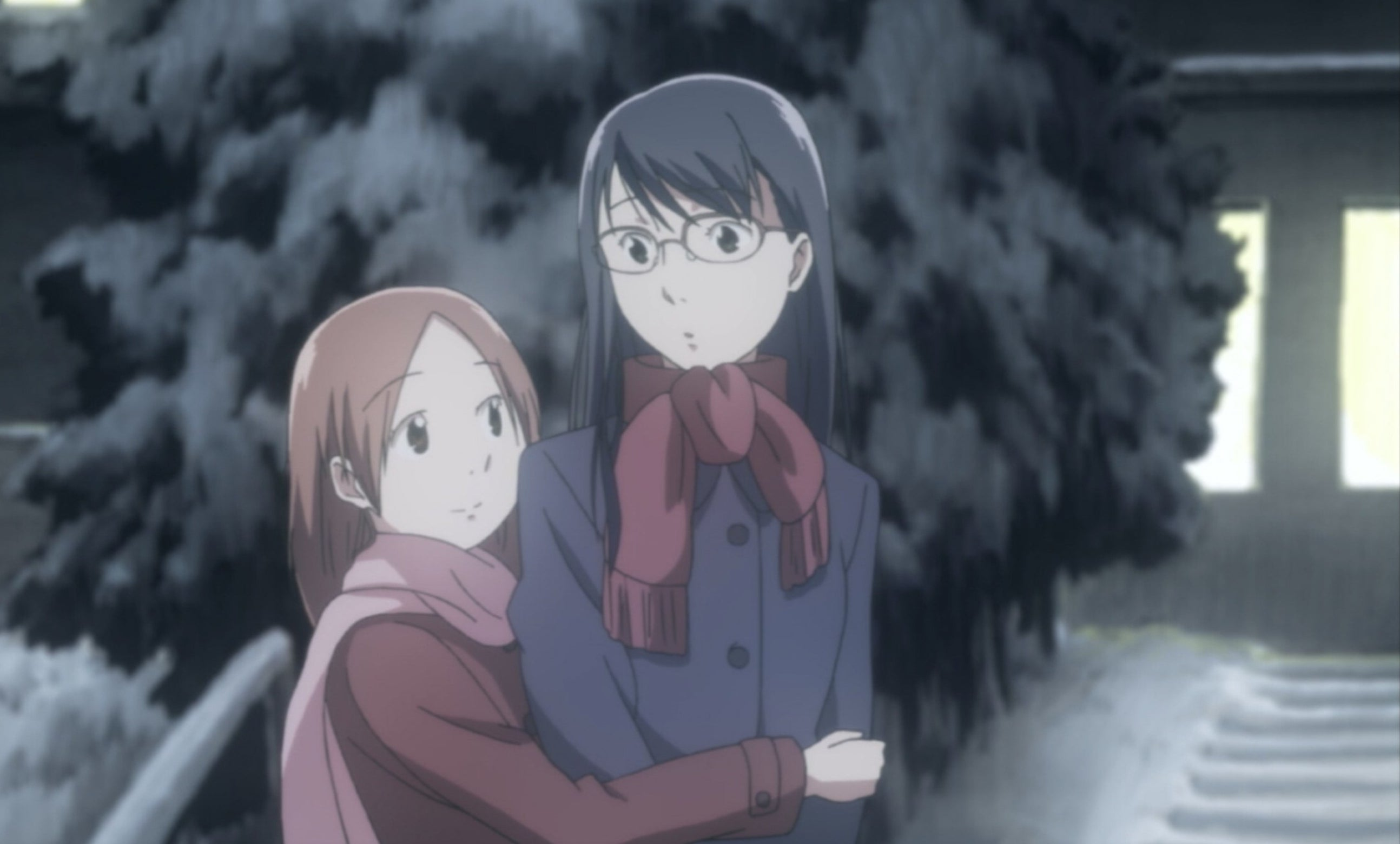 Akira hugging Fumi outside in the snow.