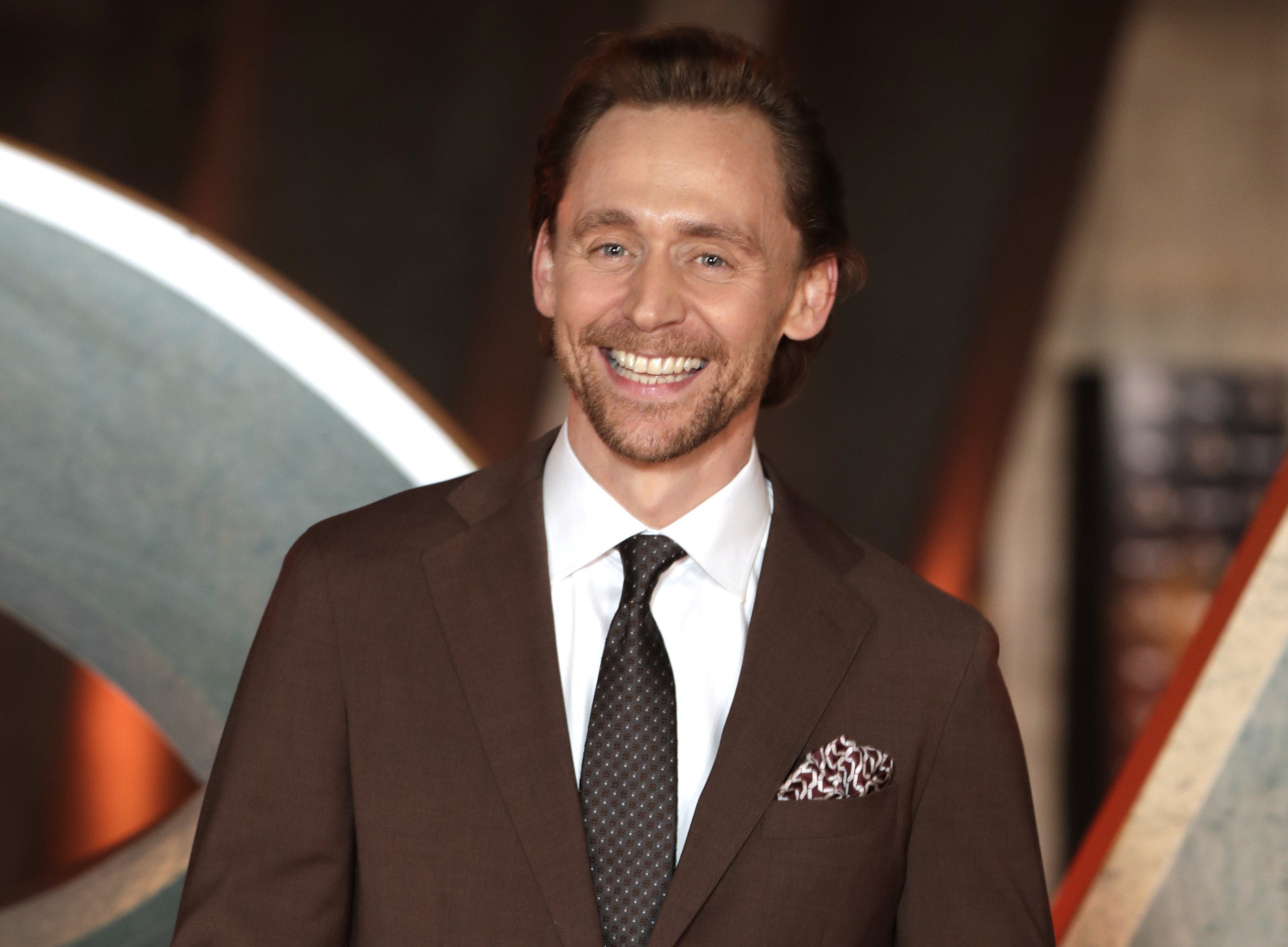 Tom smiles at a Marvel event