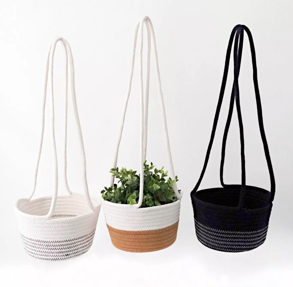 the three baskets, each in a different color pattern white and gray, white and tan, and black and cream