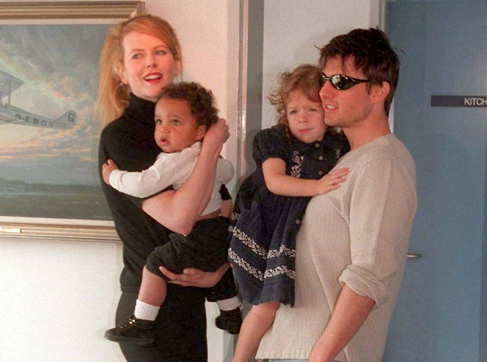 Tom and Nicole hold Connor as a baby as well as his sister