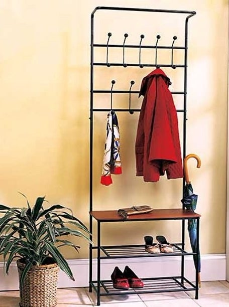 the tall metal rack with a wooden shelf and two barred shoe shelves