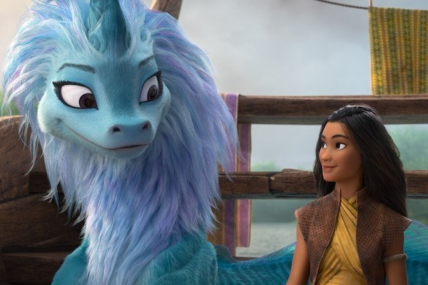 Sisu (voiced by Awkwafina) and Raya (voiced by Kelly Marie Tran) share a knowing look.