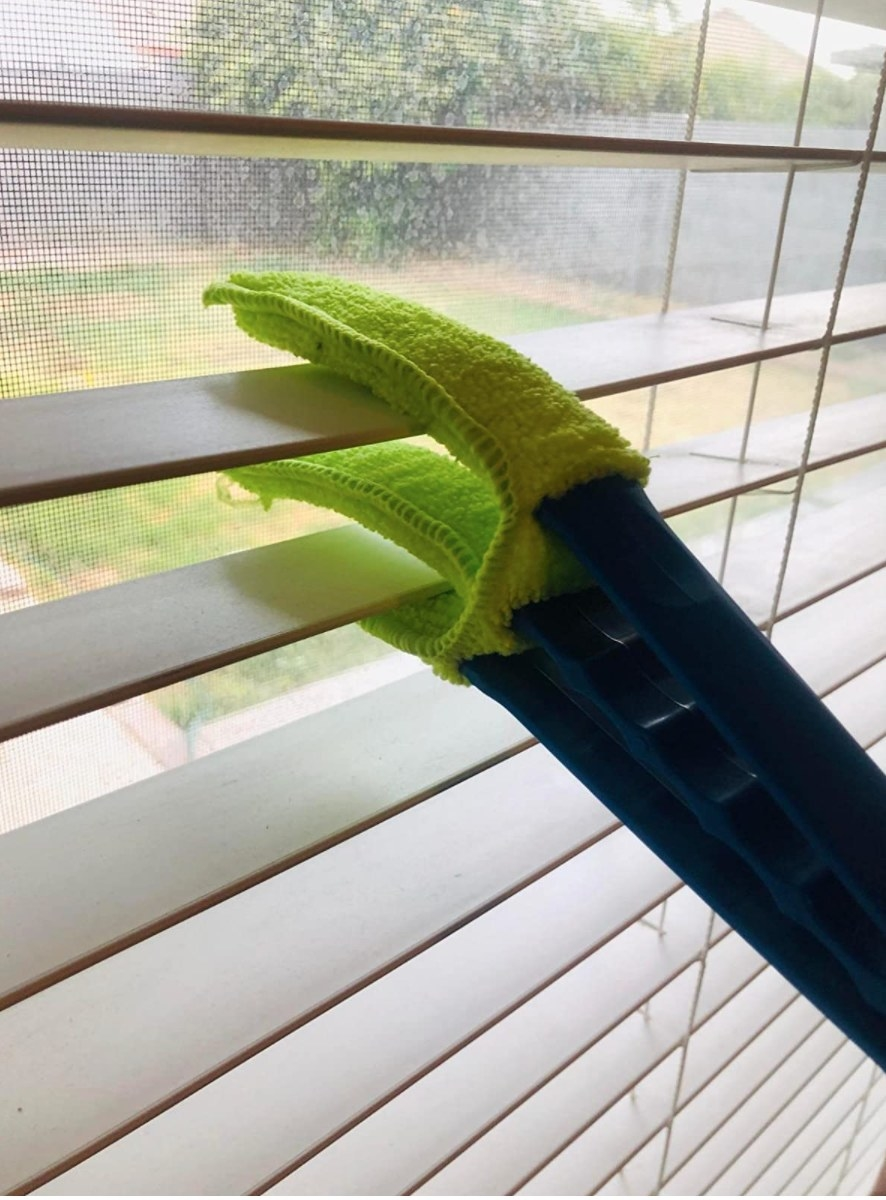 The window blind cleaner in lime green