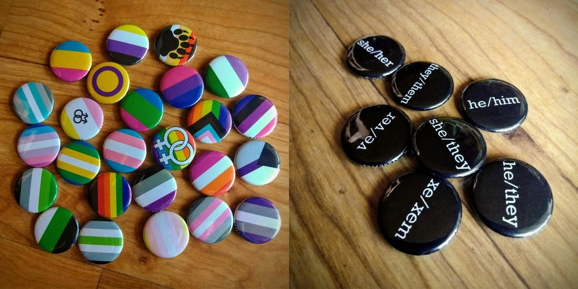 on left, various pride flag pins. on right, various black pins with pronouns