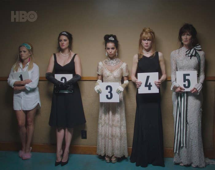 Five women in Big Little Lies hold up signs numbered one through five