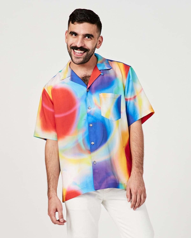 model in swirly-print short-sleeve button down shirt
