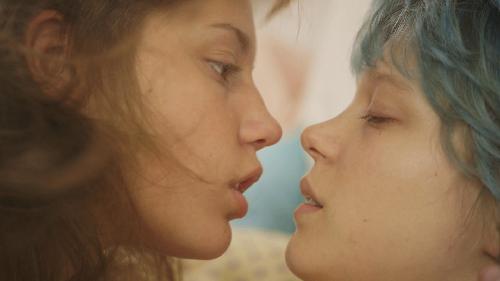 The two actresses in blue is the warmest color about to kiss