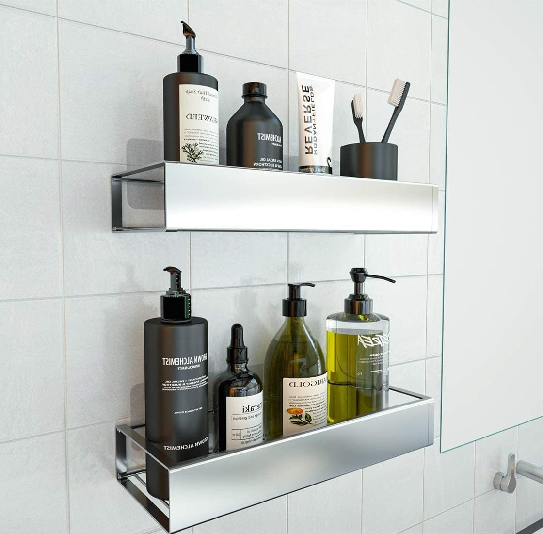 A pair of wall-mounted stainless steel shelves containing personal care products