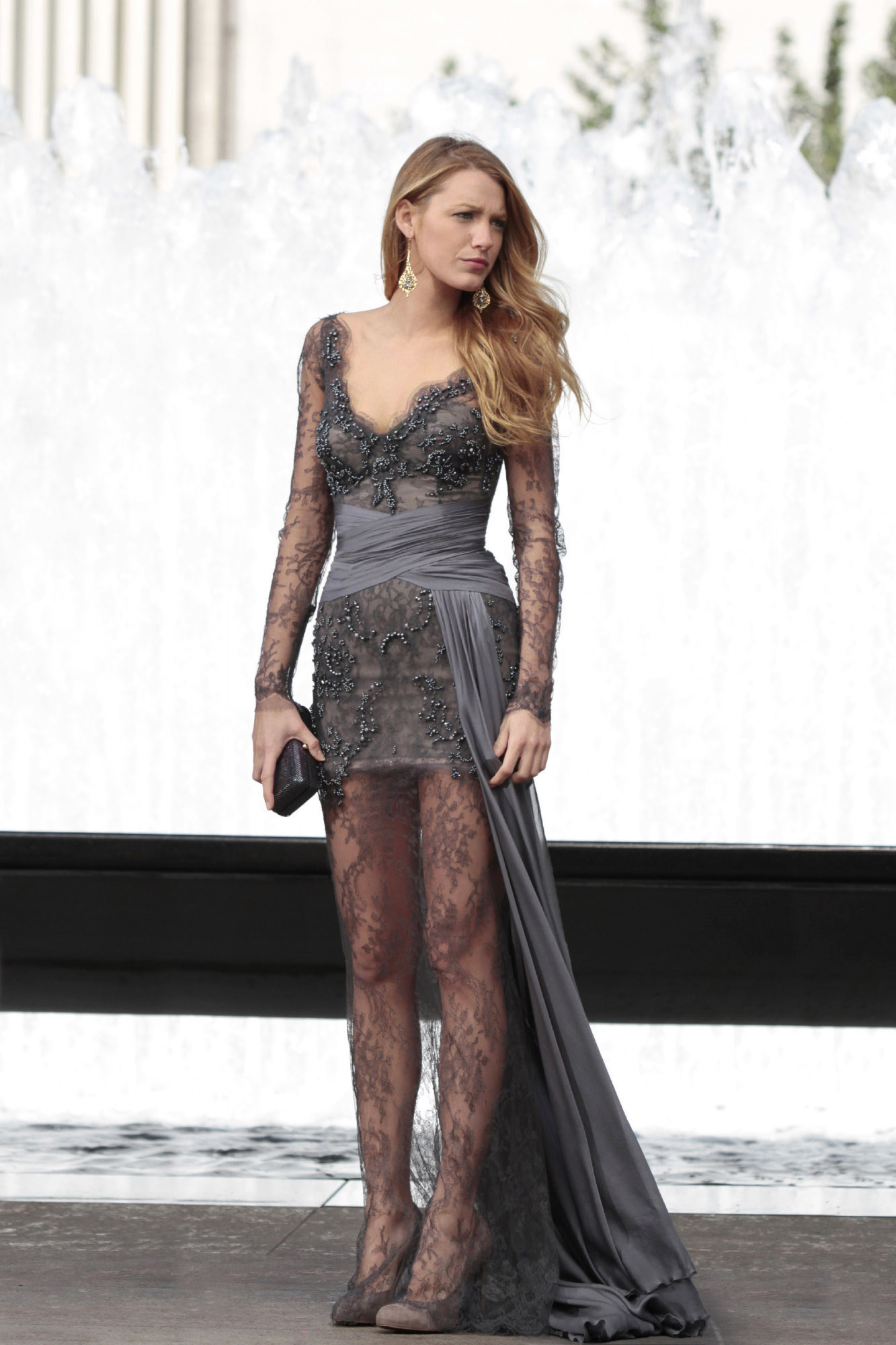 Serena in deep v long sheer sleeve dress with embroidered beading, a short tight skirt, and sheer lace long skirt, with a wrap belt that goes into a sash