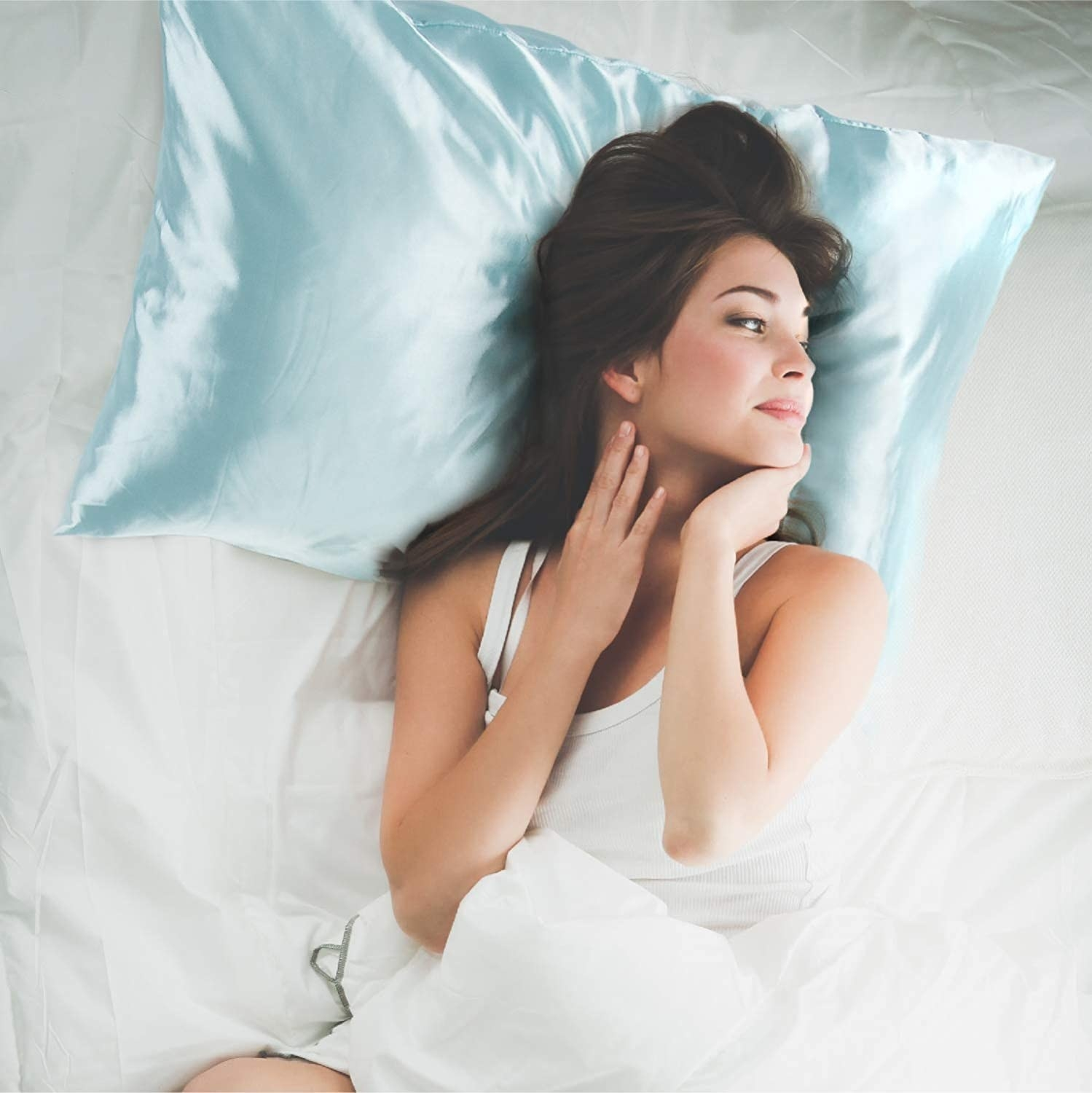 person lying on a bed with the pillowcase