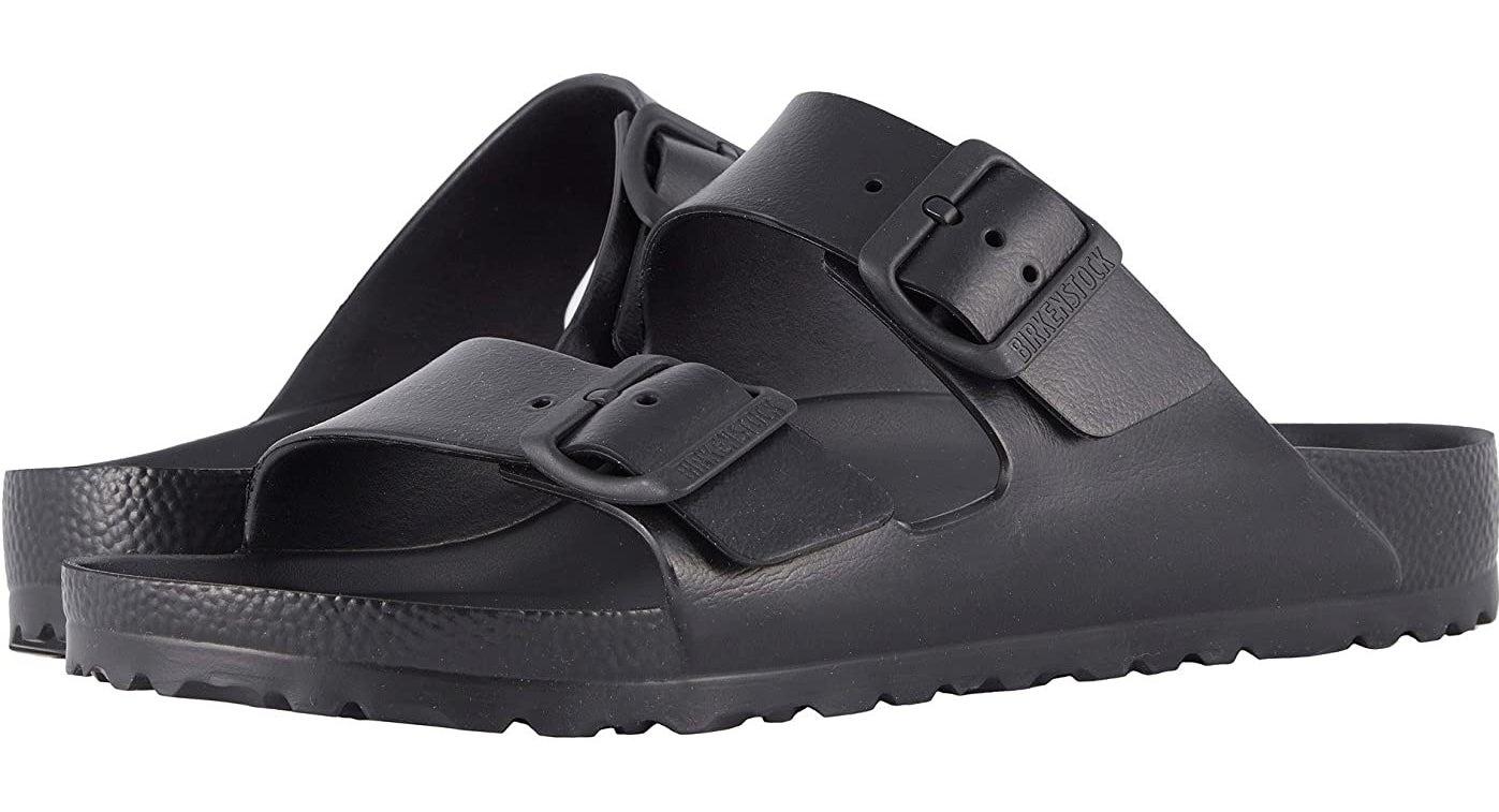 a pair of black waterproof birkenstocks