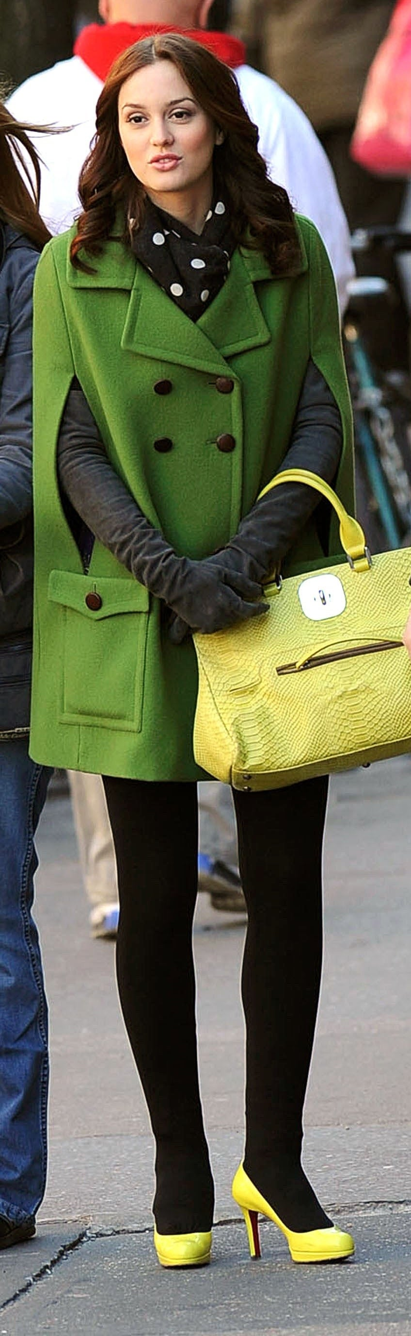 Blair in dark tights, neon shoes, a polka dot scarf, long suede gloves, a neon purse, and a bright cape peacoat