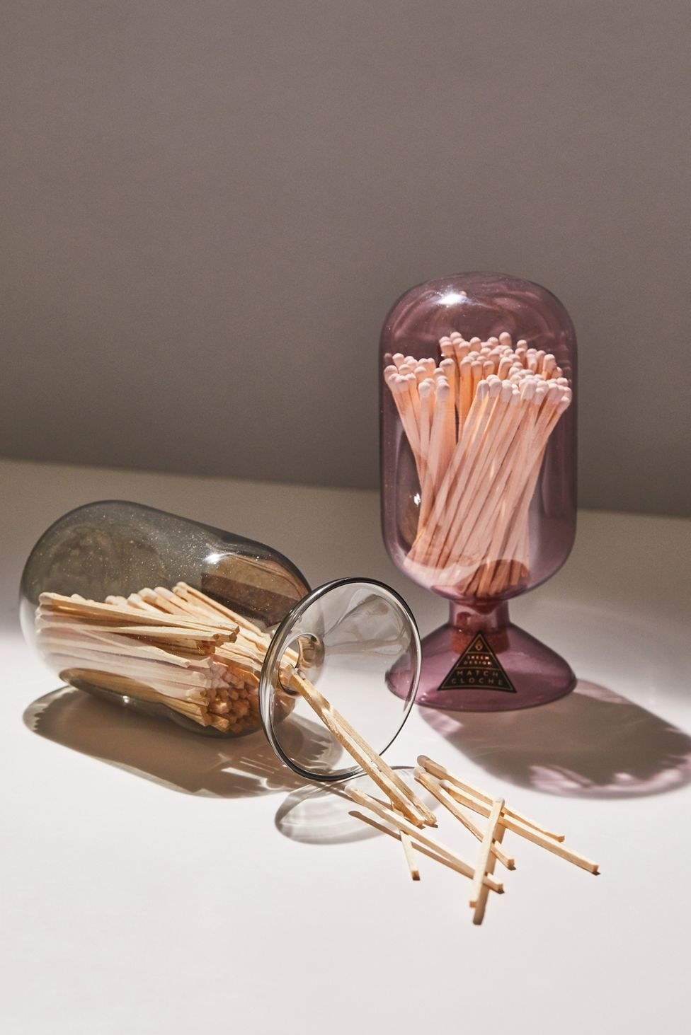 the glass cloches in black and purple with matches inside