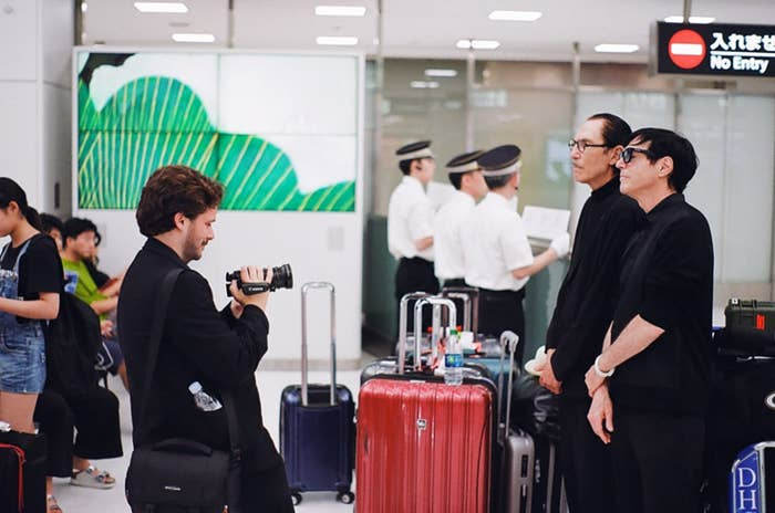 Edgar Wright holding a camcorder to film the Sparks Brothers in a Japanese airport