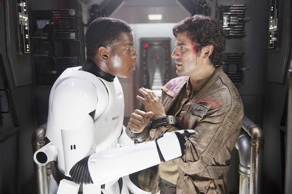 John Boyega and Oscar Isaac having a tense discussion.