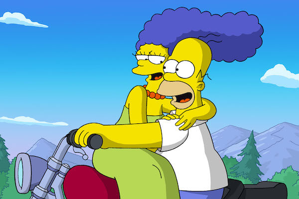Marge (voiced by Julie Kavner) and Homer Simpson (voiced by Dan Castellaneta) riding on a motorcycle.