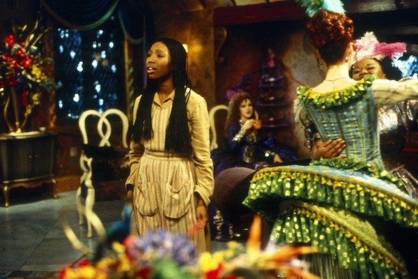 Brandy Norwood singing while Veanne Cox and Natalie Desselle Reid dance.