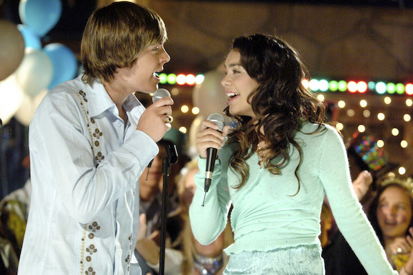 Zac Efron and Vanessa Hudgens singing karaoke.