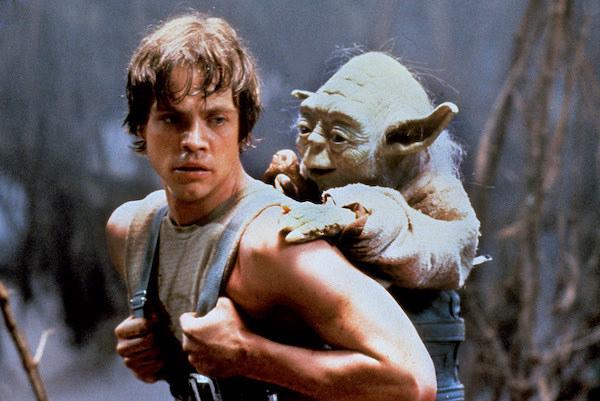 Mark Hamill giving Yoda a piggyback ride.