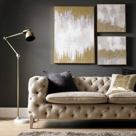 the painting on a wall in a living room