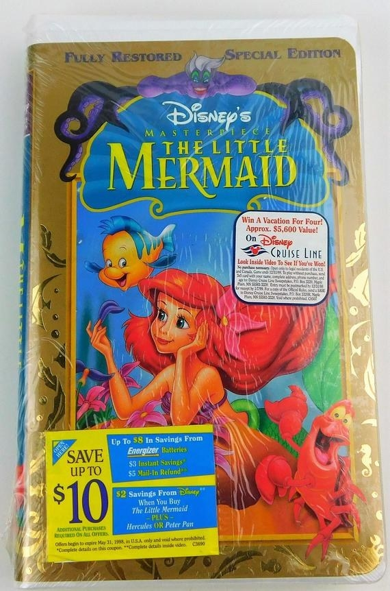A Little Mermaid VHS tape still in its packaging with a coupon sticker on the cover