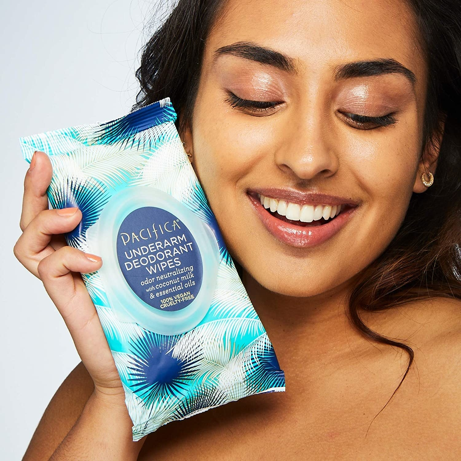 Model holding package of Pacifica Underarm Deodorant Wipes