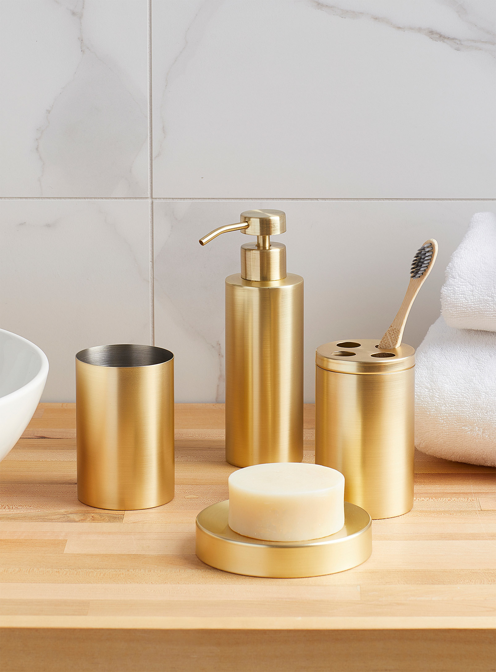 the set with a toothbrush holder, cup, soap holder, and soap pump